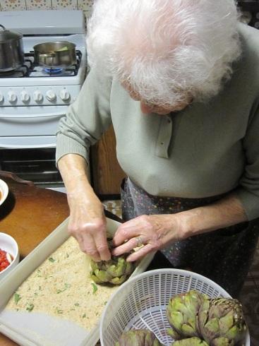 Nonna stuffing artichokes