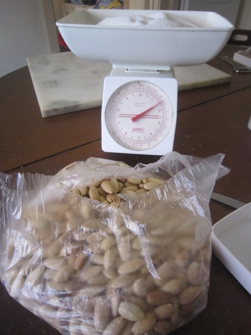 Weighing almonds and sugar
