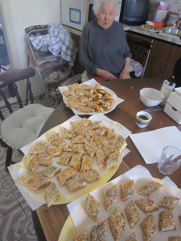 Nonna relaxes with finished torrone