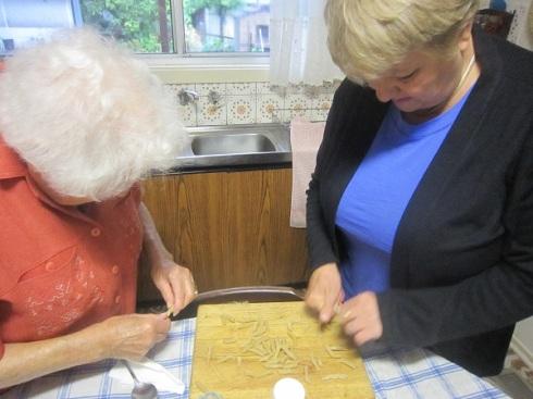 Nonna and mum re-rolling Vegemite pasta
